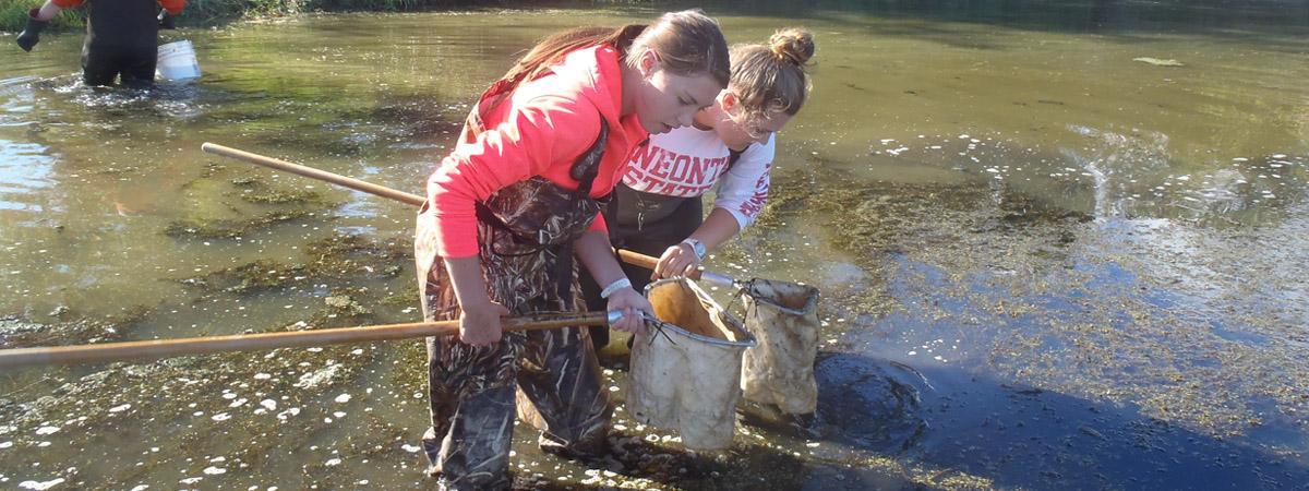 female students conducting rapid bioassessment